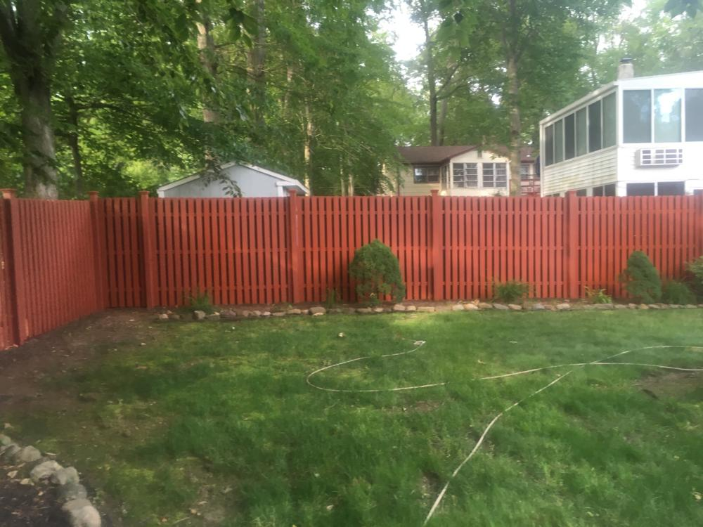 Residential exterior cedar fence painting on druid hill dr in parsippany nj